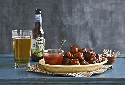 crispy pork meatballs in apple jelly cider sauce